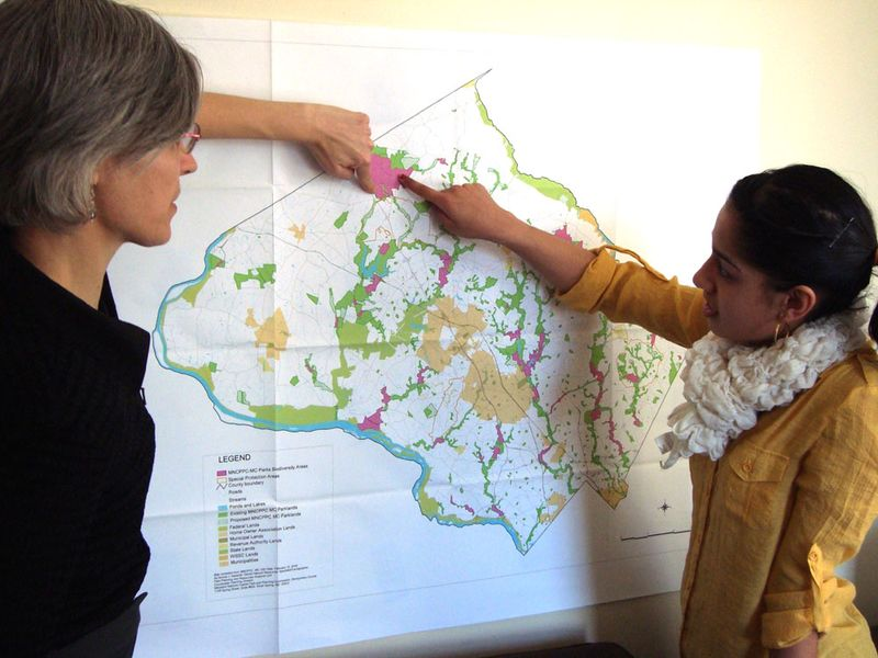 March 2013 Diane and Avantika studying a map